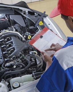 Thumb mechanic working on a car